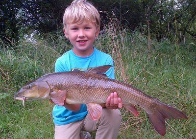 Ben aged 8 his first barbel
